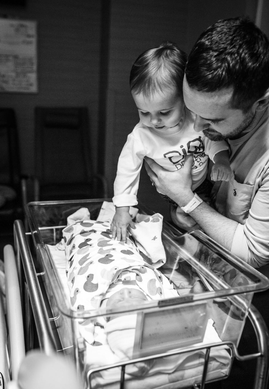Dad and sister with newborn