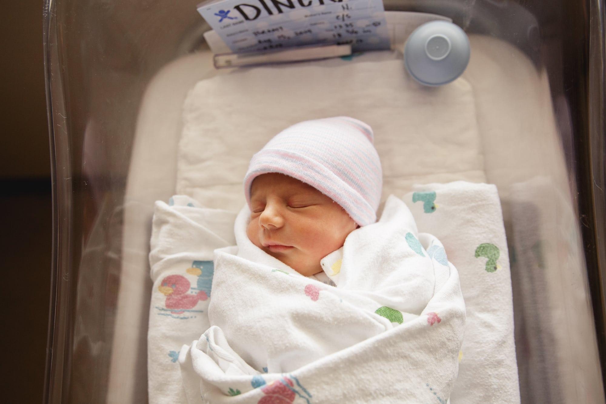 Newborn in hospital bassinet